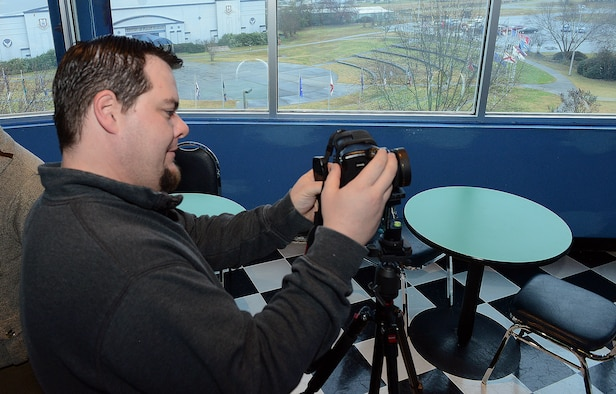 Francesco Kozerski, Global Web Advisors, sets up his camera to capture interior and exterior images at the Museum of Aviation at Robins Air Force Base, Ga. The photos will be used to create a 360-degree virtual tour of each building. (U.S. Air Force photo by Ray Crayton)