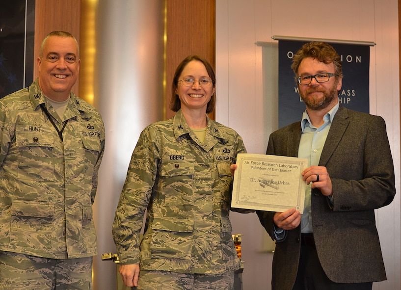 Vice Commander of the 88th Air Base Wing Colonel Elena Oberg, along with Colonel Frederick Hunt, Deputy Director of the AFRL Materials and Manufacturing Directorate, present Dr. Augustine Urbas with the Wright-Patterson Volunteer of the Quarter award at a March 9, 2016, ceremony for his work with Dayton high school students.  (U.S. Air Force photo/Marlana Sanders)