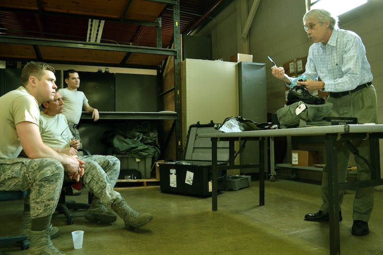 From left to right, Senior Airman Igor Karlov, Tech. Sgt. Robert Custer and Staff Sgt. Heikell Perez, all members of the 111th Logistics Readiness Squadron in the 111th Attack Wing, recieve customized training from  John Patchan, the Joint Program Executive Office-Chemical, Biological Defense Enterprise Fielding and Surveillance team leader for Team Tyndall, at Horsham Air Guard Station. Pa., March  10, 2016. The team was brought in to assist in completing M-50 Joint Service General Purpose Mask fit test assurance for the 111th Attack Wing to remain compliant. Sponsored by the National Guard Bureau, they saved the unit approximately $6,200.00 and tested an estimated 750 masks within a two-week timeframe. (U.S. Air National Guard photo by Tech. Sgt. Andria Allmond)