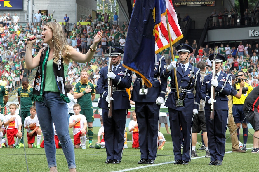 Members of the Portland Air National Guard Base Honor Guard team present the colors during the National Anthem sung by Madison Shanley, prior to the kickoff match between the Portland Timbers and Seattle Sounds, at Providence Park, Portland, Ore., June 28, 2015. (U.S. Air National Guard photo by Master Sgt. Shelly Davison, 142nd Fighter Wing Public Affairs/Released)