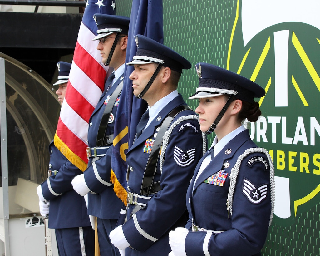 Members of the Portland Air National Guard Base Honor Guard team, from left to right, Staff Sgt. Joseph Regas, Staff Sgt. Bret Workman, Tech. Sgt. John Hughel, and Staff Sgt. Kalene Kaplan wait on the sidelines at Providence Park, Portland, Ore., to Present the Colors at the Portland Timbers soccer match against the Seattle Sounders, June 28, 2015. (U.S. Air National Guard photo by Master Sgt. Shelly Davison, 142nd Fighter Wing Public Affairs/Released)