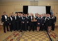The 310th Space Wing celebrates its eighteenth annual awards banquet at the Antlers Hotel in Colorado Springs, Colo., March 4, 2016. Unit of the Year, The 710th Security Forces Squadron who won the Unit of the Year award poses with the trophy. The wing sponsored the event to both recognize its annual award winners and bring Reservists together to enjoy an evening of esprit de corps, unit morale and camaraderie. (U.S. Air Force photo/Tech. Sgt. Sarah Corrice)
