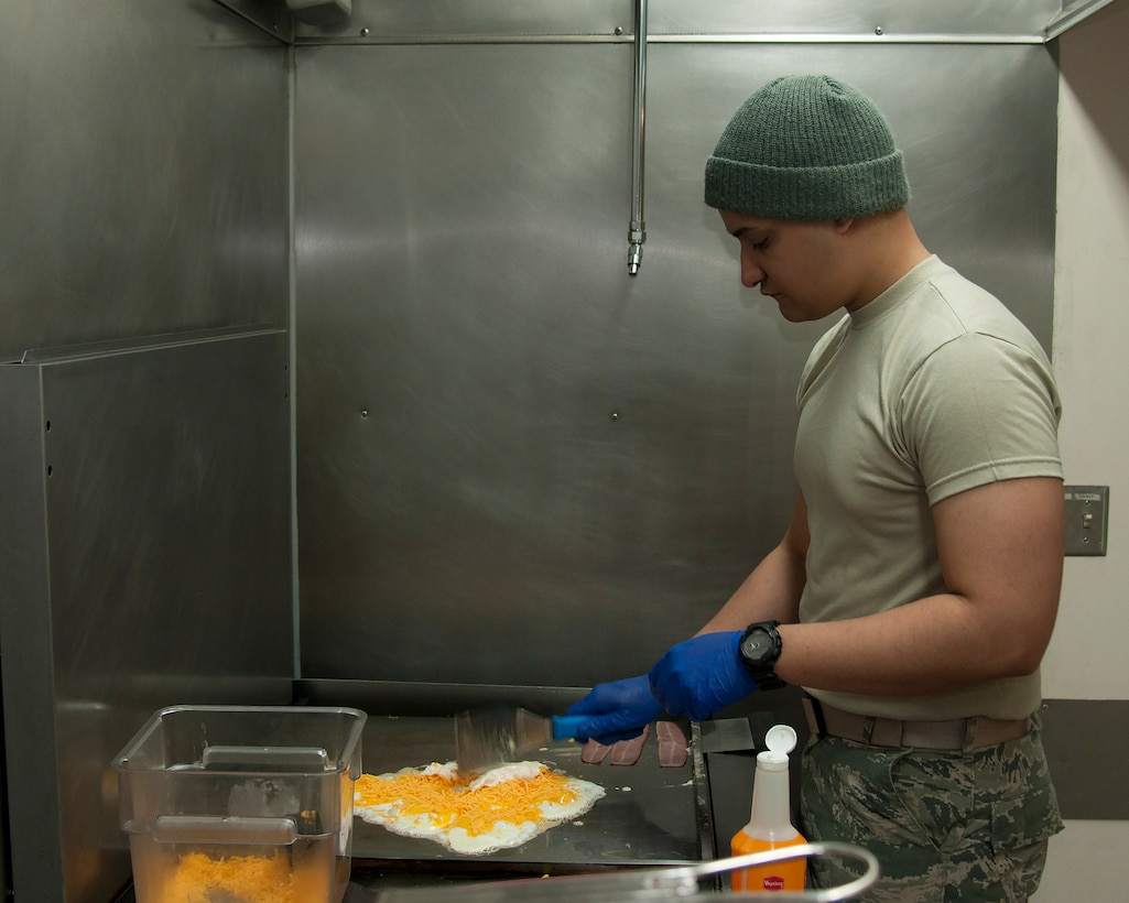 Airman 1st Class Daniyel Gonzales, 319th Missile Squadron missile chef, prepares breakfast for his fellow Airmen in a Missile Alert Facility in the F.E. Warren Air Force Base, Wyo., Missile Complex, Feb. 9, 2016. Chefs in the missile complex prepare food, act as the chiefs of morale on site and assist facility managers during emergency response. (U.S. Air Force photo by Senior Airman Jason Wiese)