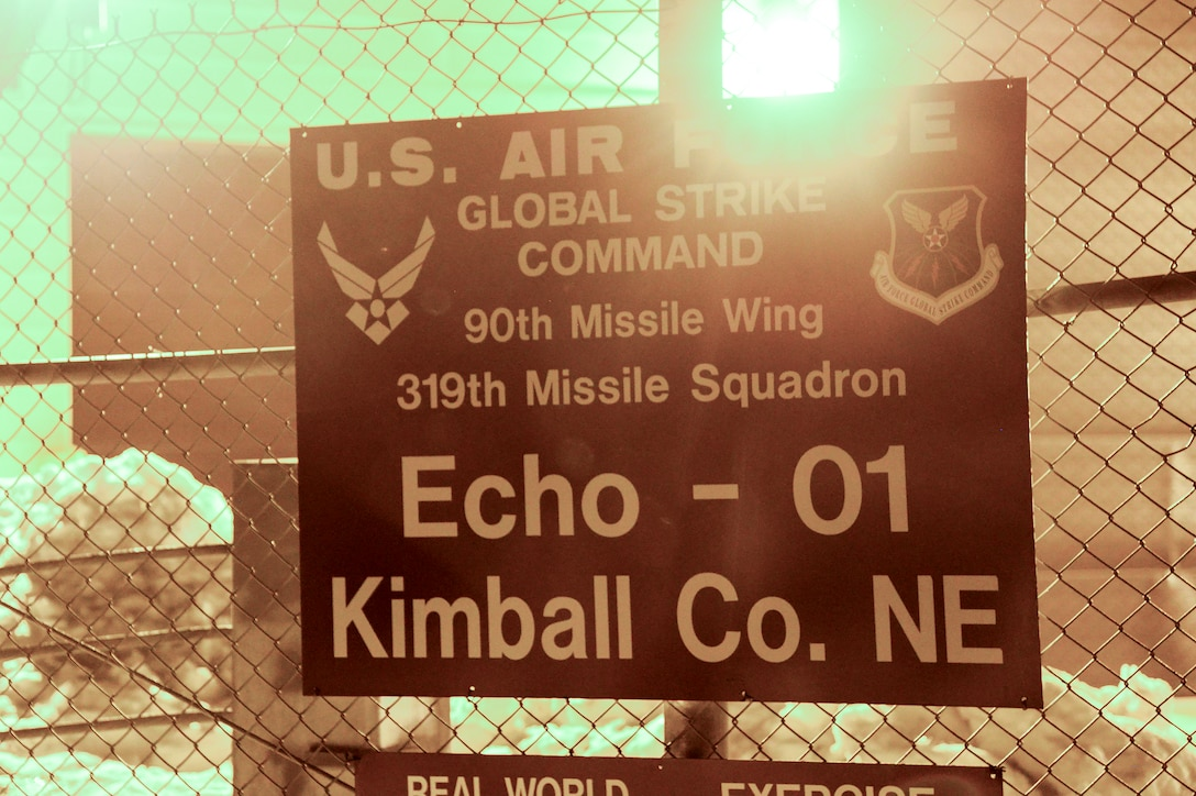 A sign hangs on the perimeter fence of a Missile Alert Facility in the F.E. Warren Air Force Base, Wyo., missile complex. MAFs house underground launch control centers in which missileers man the Minuteman III Weapon System, while topside security forces Airmen, facility managers, chefs and occasionally maintenance personnel stay to perform their critical mission roles. (U.S. Air Force photo by Senior Airman Jason Wiese)