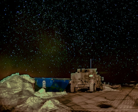 A 90th Missile Security Forces Squadron Humvee sits on the access road of a Missile Alert Facility in the F.E. Warren Air Force Base, Wyo., missile complex, in this composite of two photos taken on Feb. 8, 2016. Security forces, missileers and other 90th Missile Wing Airmen stay vigilant 24/7. (U.S. Air Force photo illustration by Senior Airman Jason Wiese)