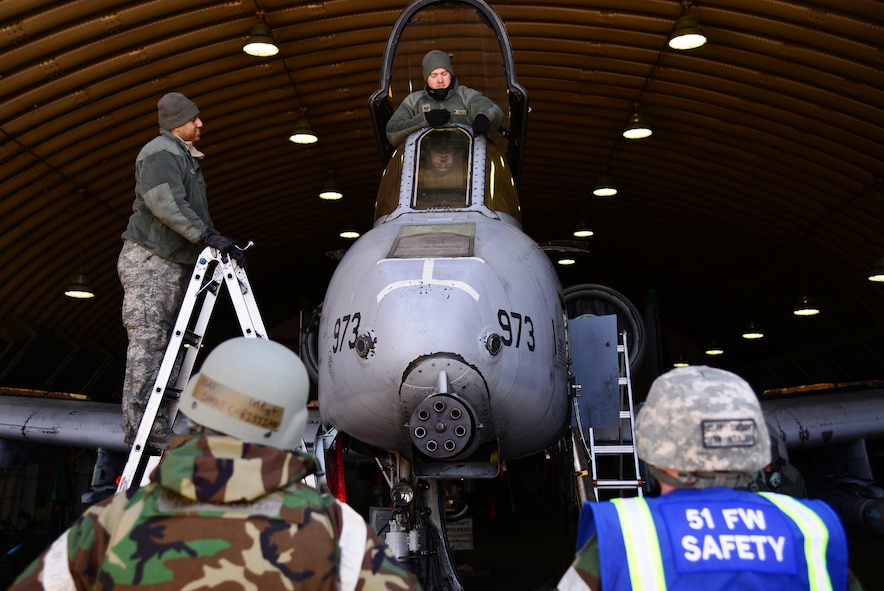 From left, Master Sgt. Shane Christian, 51st Fighter Wing occupational safety manager, and Senior Master Sgt. Sean Rouillier, 51st FW superintendent of safety, speak with Airmen assigned to the 25th Aircraft Maintenance Unit, March 10, 2016, at Osan Air Base, Republic of Korea. Airmen are performing standard maintenance along with participating in Exercise Beverly Midnight 16-01. Members of the wing safety office pull double-duty, ensuring both exercise participants and non-players are following the required safety standards. (U.S. Air Force photo by Staff Sgt. Benjamin Sutton/Released)