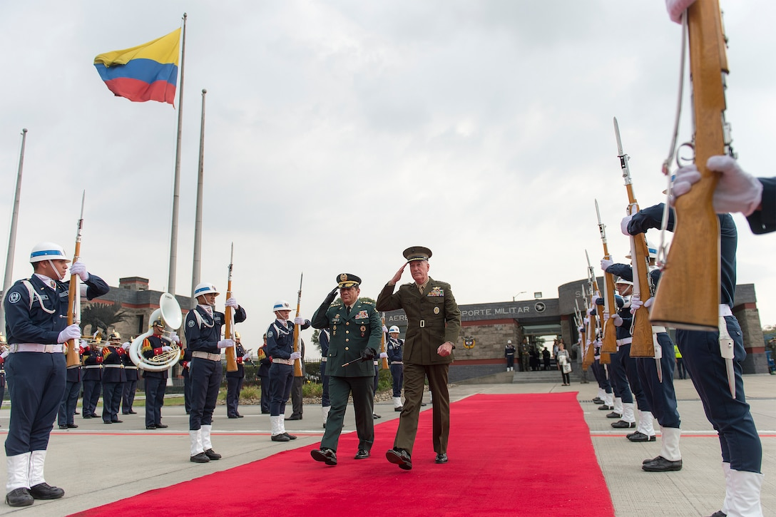 Marine Corps Gen. Joseph F. Dunford Jr., chairman of the Joint Chiefs of Staff, right, passes through a Colombian honor guard with Gen. Juan Pablo Rodriguez, commander of Colombia's armed forces, as he departs Bogota, Colombia, March 10, 2016. DoD photo by Navy Petty Officer 2nd Class Dominique A. Pineiro