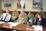 DLA Director Air Force Lt. Gen. Andy Busch (far left, front) discusses equipment and budget reductions with Army officials during Army/DLA Day at the Pentagon March 8.