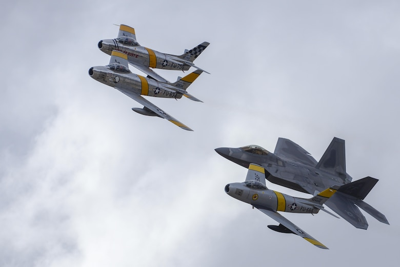 Three F-86 Sabres and an F-22 Raptor fly in formation during the 2016 Heritage Flight Training and Certification Course at Davis-Monthan Air Force Base, Ariz., March 6, 2016. Established in 1997, the course certifies civilian pilots of historic military aircraft and Air Force pilots to fly in formation together during the upcoming air show season. (U.S. Air Force photo/Senior Airman Chris Massey)