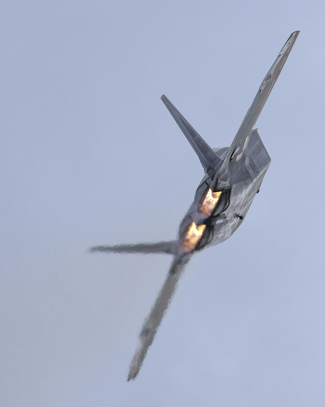 An F-22 Raptor performs an aerial maneuver during the 2016 Heritage Flight Training and Certification Course at Davis-Monthan Air Force Base, Ariz., March 5, 2016. The Raptor performs both air-to-air and air-to-ground missions allowing full realization of operational concepts vital to the 21st-century Air Force. (U.S. Air Force photo/Senior Airman Chris Massey)