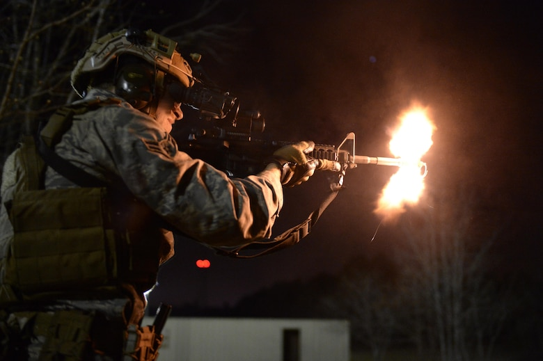 Airman 1st Class Sean Carnes, a 1st Combat Camera Squadron combat photojournalist, fires an M4 carbine rifle as part of tactics training in exercise Scorpion Lens 2016 at Fort Jackson, S.C., March 7, 2016. The exercise is twofold containing the Scorpion Lens portion, which is dedicated to advanced weapons and tactical training, and the flash bang portion, which practices photography and videography documentation standards in combat situations. The purpose of the training is to provide refresher training to combat camera personnel. (U.S. Air Force photo/Staff Sgt. Jonathan Snyder)