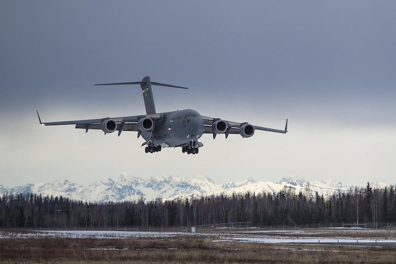 A C-17 Globemaster III from the 517th Airlift Squadron lands at Bryant Army Airfield on Joint Base Elmendorf-Richardson, Alaska, March 7, 2016. The event marked the first time a C-17 has taken off from the airfield since its construction in 1958, when the runway was built by the Army on then-separate Fort Richardson to support Soldiers in remote areas of Alaska. (U.S. Air Force photo/Senior Airman James Richardson)