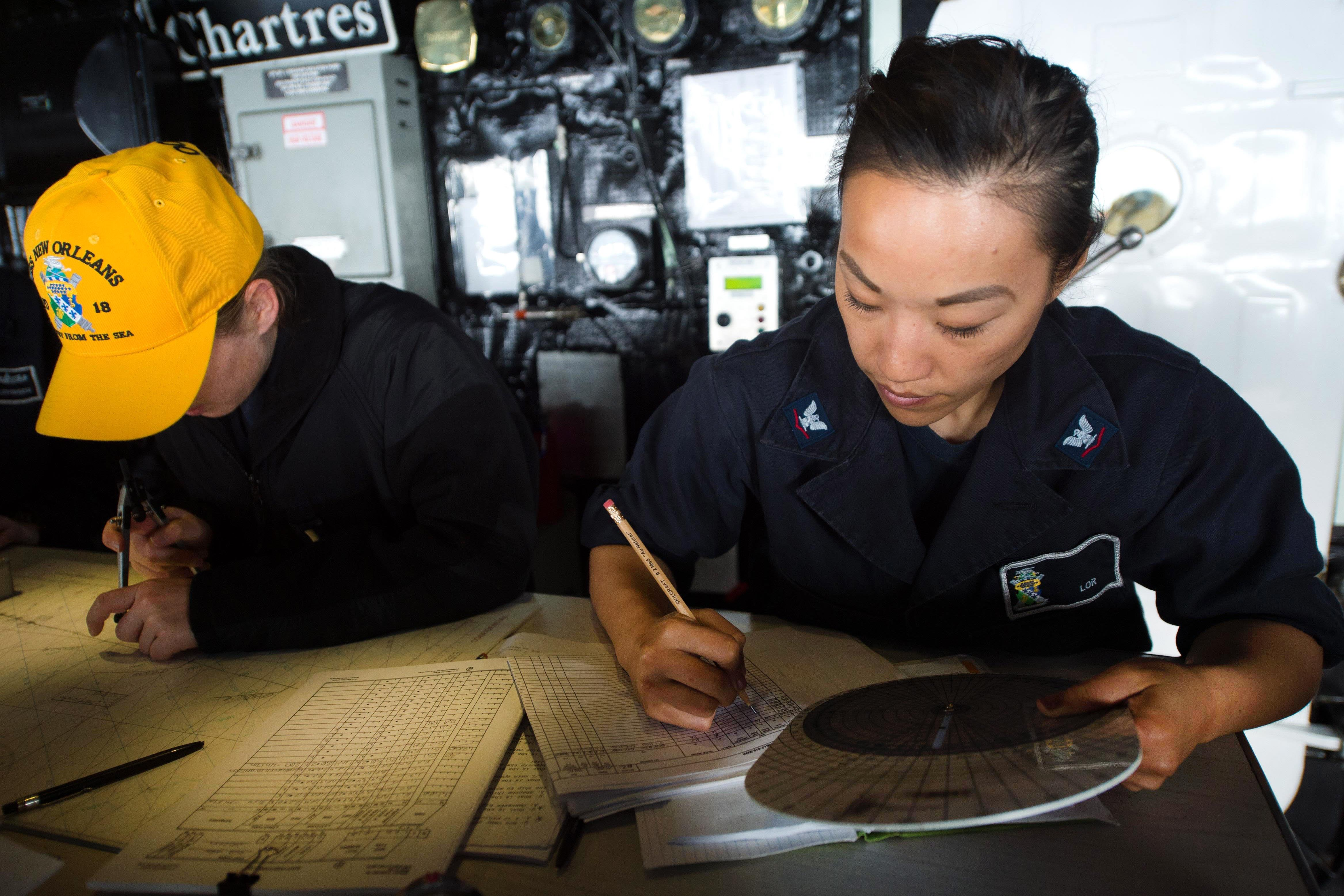 navy petty officer 3rd class christina lor right and navy ensign kristin rovito chart
