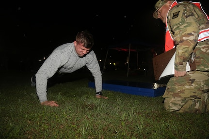 U.S. Army Sgt. Jacob Pulliman of the 379th Battalion from Arkansas performs push-ups for the Army Physical Fitness Test during the Best Warrior Competition (BWC) at Camp Bullis, Texas, March 10, 2016. The BWC is an annual competition to identify the strongest and most well-rounded Soldiers through the accomplishment of physical and mental challenges, as well as basic Soldier skills. (U.S. Army photo by Spc. Darnell Torres)