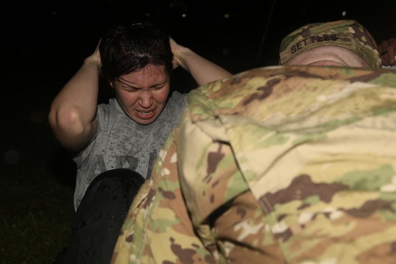 U.S. Army Sgt. Marcy DiOssi of 102nd Division Fort Loenard Wood, performs the situp for the Army Physical Fitness Test event during the Best Warrior Competition (BWC) at Camp Bullis, Texas, March 10, 2016. The BWC is an annual competition to identify the strongest and most well-rounded Soldiers through the accomplishment of physical and mental challenges, as well as basic Soldier skills. (U.S. Army photo by Spc. Darnell Torres).