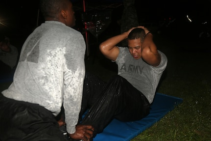 U.S. Army Staff Sgt. Julises Abdon of the 5/80th Ordnance Battalion performs the situp for the Army Physical Fitness Test event during the Best Warrior Competition (BWC) at Camp Bullis, Texas, March 10, 2016. The BWC is an annual competition to identify the strongest and most well-rounded Soldiers through the accomplishment of physical and mental challenges, as well as basic Soldier skills. (U.S. Army photo by Spc. Darnell Torres)