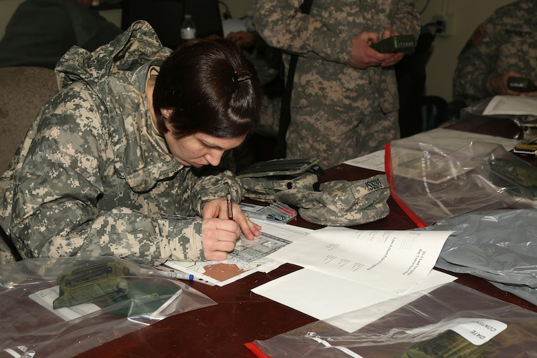 U.S. Army Sgt. Marcy DiOssi of the 102nd Division from  Fort Leonard Wood, Mo. plots a point for an upcoming Land Navigation event during the Best Warrior Competition (BWC) at Camp Bullis, Texas, March 10, 2016. The BWC is an annual competition to identify the strongest and most well-rounded Soldiers through the accomplishment of physical and mental challenges, as well as basic Soldier skills. (U.S. Army photo by Spc. Darnell Torres)