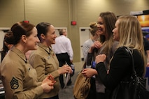 Staff Sgt. Nancy Wright (far left), and Lt. Col. Jenifer Nothelfer (middle left) speak with two attendees at the 2016 Women in Aviation International Symposium in Nashville, Tenn., March 10. This event gives Marines an opportunity to engage with young men and women who are interested in aviation careers and to let them know the Marine Corps is a viable option for them. Wright currently serves as the officer selection officer assistant, Recruiting Station Atlanta. Nothelfer currently serves as the recruiting support officer, Recruiting Station Des Moines.