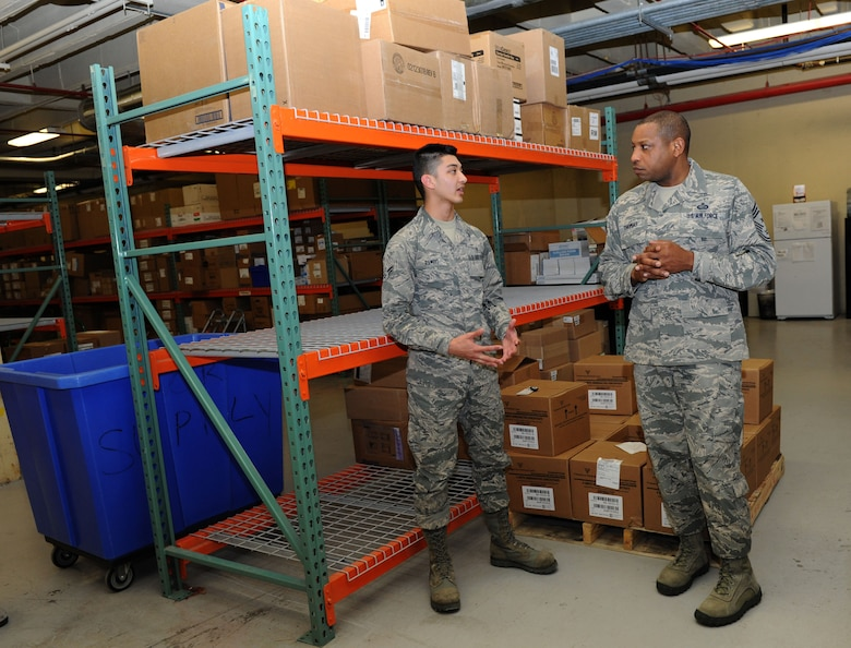 Airman 1st Class Jason Rambo, 81st Medical Support Squadron medical logistics technician, briefs Chief Master Sgt. Farrell Thomas, 2nd Air Force command chief, on medical logistics during an immersion tour at the Keesler Medical Center Mar.8, 2016, Keesler Air Force Base, Miss. Thomas visited the 81st Medical Group to become oriented with group missions, operations and personnel. (U.S. Air Force photo by Kemberly Groue)