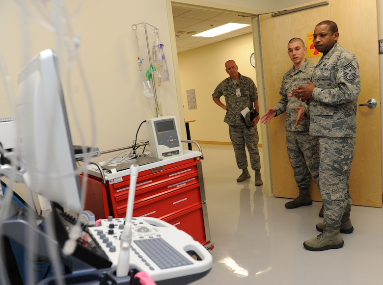 Col. Thomas Harrell, 81st Medical Group commander, stands by as Airman 1st Class David Wiley, 81st Medical Support Squadron biomedical equipment technician, provides Chief Master Sgt. Farrell Thomas, 2nd Air Force command chief, a tour inside the medical equipment repair shop during an immersion tour at the Keesler Medical Center Mar.8, 2016, Keesler Air Force Base, Miss. Thomas visited the 81st MDG to become oriented with group missions, operations and personnel. (U.S. Air Force photo by Kemberly Groue)