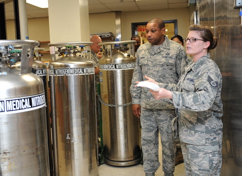 Chief Master Sgt. Farrell Thomas, 2nd Air Force command chief, receives a tour of the clinical research lab from Staff Sgt. Mandy Polen, 81st Medical Support Squadron clinical research laboratory NCO in charge, during an immersion tour Mar.8, 2016, Keesler Air Force Base, Miss. Thomas visited the 81st Medical Group to become oriented with group missions, operations and personnel. (U.S. Air Force photo by Kemberly Groue)