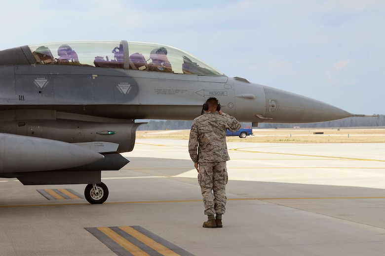 Canadian Forces Brig. Gen. Alain Pelletier, deputy commander Continental United States NORAD Region, receives and orientation flight on a SCANG F-16 Fighting Falcon fighter jet accompanied by Lt. Col. Ian Toogood, a fighter pilot and Commander of the Aerospace Control Alert Squadron, during his visit to the South Carolina Air National Guard's 169th Fighter Wing at McEntire Joint National Guard Station, Mar. 1, 2016. During his visit, he spoke to wing leadership about its homeland defense mission and the relationship it has with the NORAD air component as it is tasked through CONR to ensure North American airspace control. The 169th FW has provided support for numerous CONR training and air defense events in past years. Brig. Gen. Pelletier also received an orientation flight on a SCANG F-16 Fighting Falcon fighter jet and a tour of the installation. (U.S. Air National Guard photo by Senior Airman Ashleigh Pavelek)