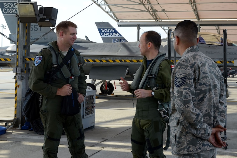 Canadian Forces Brig. Gen. Alain Pelletier, deputy commander Continental United States NORAD Region (CONR), receives and orientation flight on an F-16 Fighting Falcon fighter jet accompanied by Lt. Col. Ian Toogood, commander of the 169th Aerospace Control Alert Squadron, during his visit to the South Carolina Air National Guard's 169th Fighter Wing at McEntire Joint National Guard Station, Mar. 1, 2016. During his visit, Brig. Gen. Pelletier spoke to wing leadership about its homeland defense mission and the relationship it has with the NORAD air component as it is tasked through CONR to ensure North American airspace control. The 169th FW has provided support for numerous CONR training and air defense events in past years. (U.S. Air National Guard photo by Senior Airman Ashleigh Pavelek)