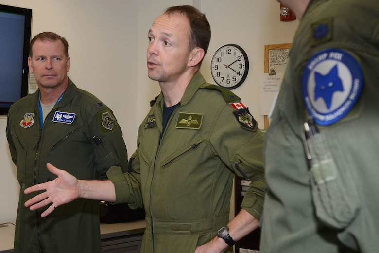 Canadian Forces Brig. Gen. Alain Pelletier, deputy commander Continental United States NORAD Region, center, speaks with personnel assigned to the South Carolina Air National Guard's 169th Fighter Wing at McEntire Joint National Guard Station,  Feb. 29 2016. During his visit, he spoke to wing leadership about its homeland defense mission and the relationship it has with the NORAD air component as it is tasked through CONR to ensure North American airspace control. The 169th FW has provided support for numerous CONR training and air defense events in past years. Brig. Gen. Pelletier also received an orientation flight on a SCANG F-16 Fighting Falcon fighter jet and a tour of the installation. (U.S. National Guard photo by Airman 1st Class Megan Floyd)