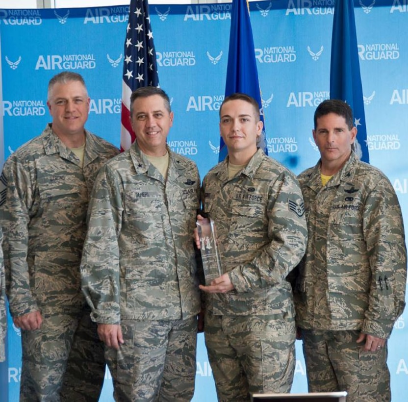 Staff Sgt. Patrick O'Connor, Air Reserve Personnel Center DD 214 service technician, was selected as the 2015 Air National Guard Readiness Center Airman of the Year by Brig. Gen. Michael Taheri, ANGRC commander, Feb. 26, 2016, at Joint Base Andrews, Md. Included in the photo are Chief Master Sgt. Sean Strong, ARPC TFSC superintendent, Brig. Gen. Michael Taheri, Staff Sgt. Patrick O'Connor and Col. Michael Gerock, National Guard Bureau Manpower Personnel and Services director. (Air Force courtesy photo)