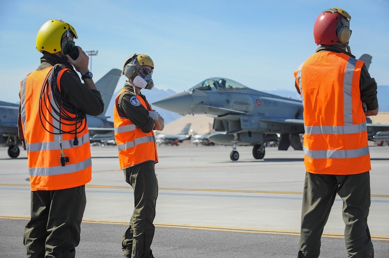 Crew members from the 4th Fighter Wing, Grosseto, Italy, conducts pre-flight checks in preparation for take-off during Red Flag 16-2 March 3, 2016 at Nellis Air Force Base, Nev. Red Flag provides an opportunity for aircrew and maintainers to enhance their tactical operational skills alongside military aircraft from coalition forces. (U.S. Air Force photo by Senior Airman Jake Carter)