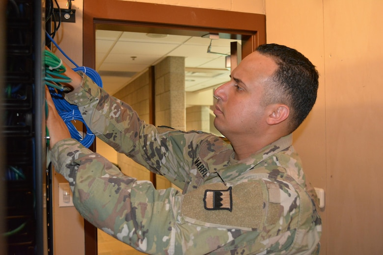 Staff Sgt. Hector Marrero, an Information Technology Specialist assigned to the 80th Training Command, trouble shoots computer connectivity in The Army School System Training Center's Network Operation Command, Grand Prairie, Texas, March 7, 2016.