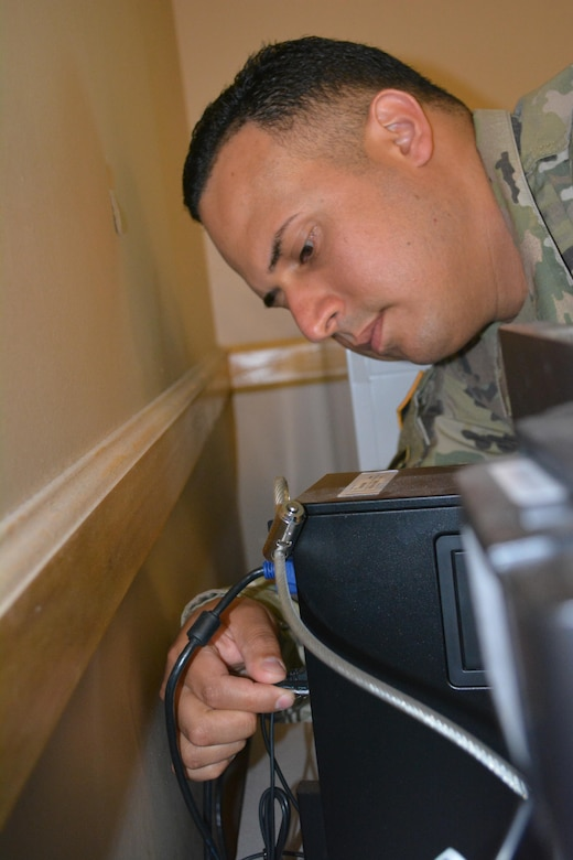 Staff Sgt. Hector Marrero an Information Technology Specialist assigned to the 80th Training Command, works on personal computer at The Army School System Training Center, Grand Prairie, Texas, March 7, 2016.