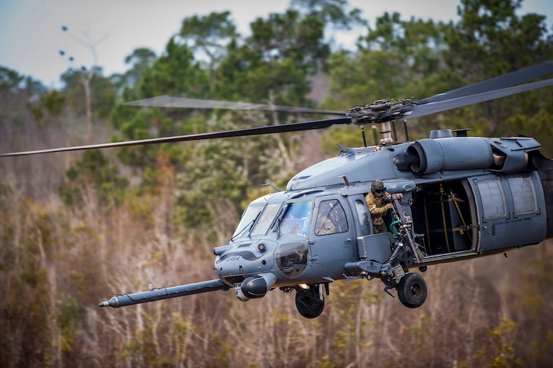 Airmen from the 41st Rescue Squadron take off in an HH-60G Pave Hawk helicopter during a training exercise, Jan. 26, 2016, at Moody Air Force Base, Ga. The HH-60G is armed with two individually-manned .50-caliber machine guns that Airmen fired at ground targets during the training. (U.S. Air Force photo by Airman 1st Class Lauren M. Johnson/Released)