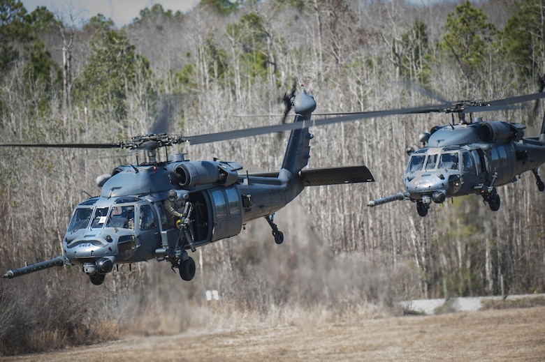 Airmen from the 41st Rescue Squadron take off in HH-60G Pave Hawk helicopters during a training exercise, Jan. 26, 2016, at Moody Air Force Base, Ga. The primary mission of the HH-60G is to conduct rescue operations in hostile environments to recover isolated personnel. (U.S. Air Force photo by Airman 1st Class Lauren M. Johnson/Released)