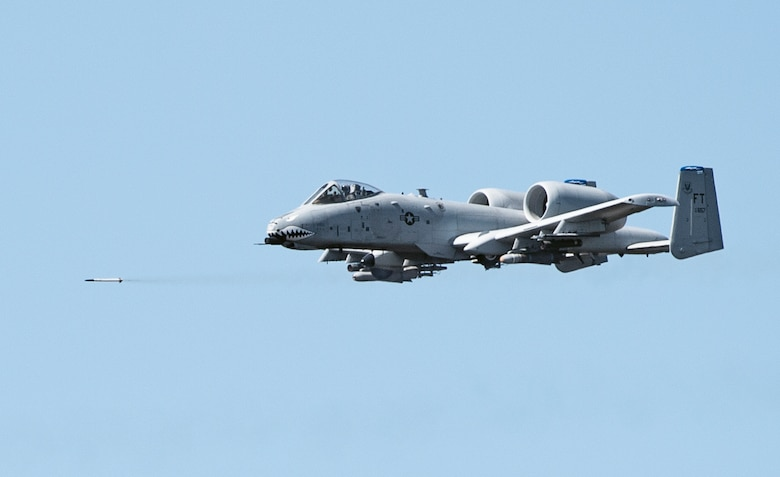 An A-10 Thunderbolt II fires an air-to-surface missile over the Grand Bay Bombing and Gunnery Range at Moody Air Force Base, Ga., Feb. 11, 2016. Multiple U.S. Air Force aircraft within Air Combat Command conducted joint aerial training that showcased the aircrafts tactical air and ground maneuvers, as well as its weapons capabilities. (U.S. Air Force photo by Staff Sgt. Brian J. Valencia/Released)