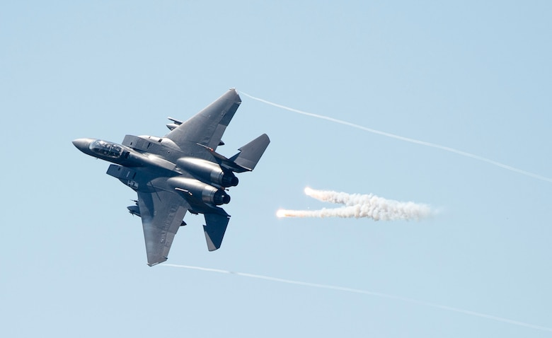 An F-15E Strike Eagle releases flares over Grand Bay Bombing and Gunnery Range at Moody Air Force Base, Ga., Feb. 18, 2016. Multiple U.S. Air Force aircraft within Air Combat Command conducted joint combat rescue and aerial training that showcased the aircrafts tactical air and ground maneuvers, as well as its weapons capabilities. (U.S. Air Force photo by Staff Sgt. Brian J. Valencia/Released)