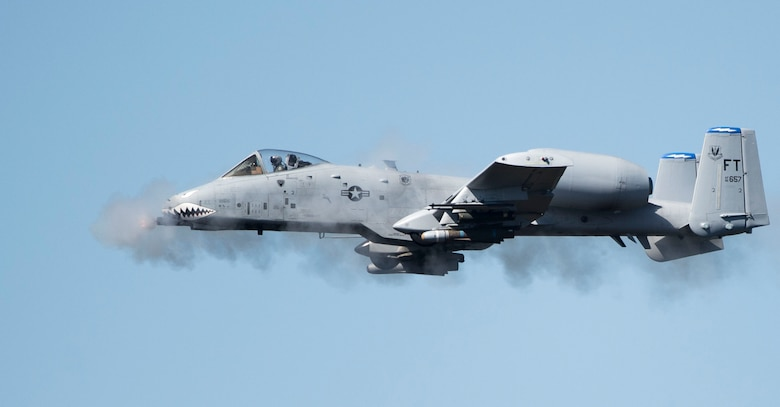 An A-10 Thunderbolt II fires the GAU-8 Avenger, a 30mm Gatling-style canon, over the Grand Bay Bombing and Gunnery Range at Moody Air Force Base, Ga., Feb. 11, 2016. Multiple U.S. Air Force aircraft within Air Combat Command conducted joint aerial training that showcased the aircrafts tactical air and ground maneuvers, as well as its weapons capabilities. (U.S. Air Force photo by Staff Sgt. Brian J. Valencia/Released)