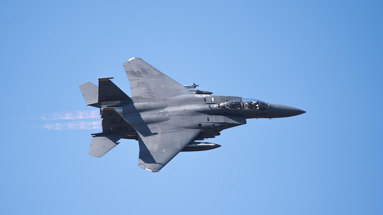 An F-15E Strike Eagle flies over Grand Bay Bombing and Gunnery Range at Moody Air Force Base, Ga., Feb. 11, 2016. Multiple U.S. Air Force aircraft within Air Combat Command conducted joint aerial training that showcased the aircrafts tactical air and ground maneuvers, as well as its weapons capabilities. (U.S. Air Force photo by Staff Sgt. Brian J. Valencia/Released)