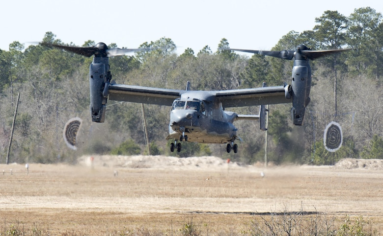 A CV-22 Osprey comes in for a landing on Grand Bay Bombing and Gunnery Range at Moody Air Force Base, Ga., Feb. 18, 2016. Multiple U.S. Air Force aircraft within Air Combat Command conducted joint combat rescue and aerial training that showcased the aircrafts tactical air and ground maneuvers, as well as its weapons capabilities. (U.S. Air Force photo by Staff Sgt. Brian J. Valencia/Released)