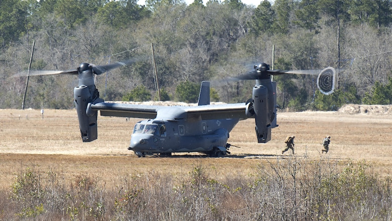 A CV-22 Osprey deploys a tactical air control party onto the ground of Grand Bay Bombing and Gunnery Range at Moody Air Force Base, Ga., Feb. 18, 2016. Multiple U.S. Air Force aircraft within Air Combat Command conducted joint combat rescue and aerial training that showcased the aircrafts tactical air and ground maneuvers, as well as its weapons capabilities. (U.S. Air Force photo by Staff Sgt. Brian J. Valencia/Released)