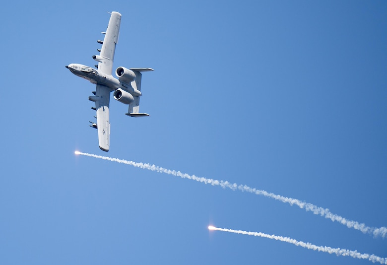 An A-10 Thunderbolt II releases flares over Grand Bay Bombing and Gunnery Range at Moody Air Force Base, Ga., Feb. 18, 2016. Multiple U.S. Air Force aircraft within Air Combat Command conducted joint combat rescue and aerial training that showcased the aircrafts tactical air and ground maneuvers, as well as its weapons capabilities. (U.S. Air Force photo by Staff Sgt. Brian J. Valencia/Released)