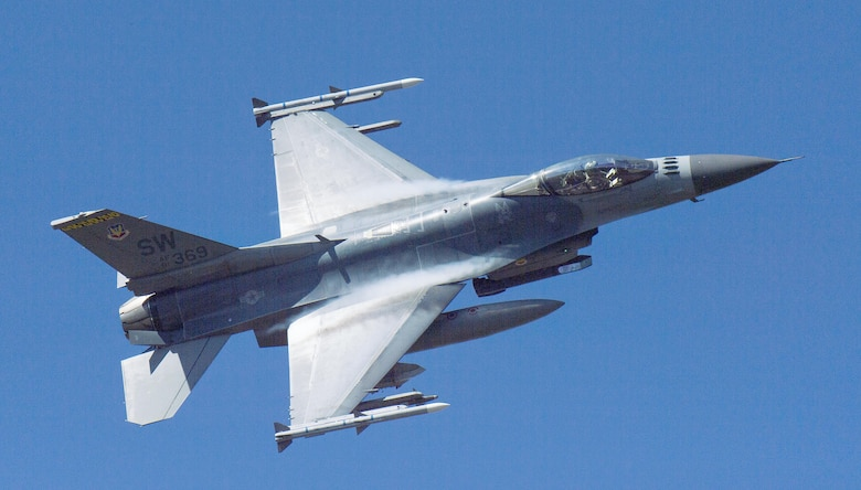 An F-16 Fighting Falcon flies over Grand Bay Bombing and Gunnery Range at Moody Air Force Base, Ga., Feb. 18, 2016. Multiple U.S. Air Force aircraft within Air Combat Command conducted joint aerial training that showcased the aircrafts tactical air and ground maneuvers, as well as its weapons capabilities. (U.S. Air Force photo by Staff Sgt. Brian J. Valencia/Released)