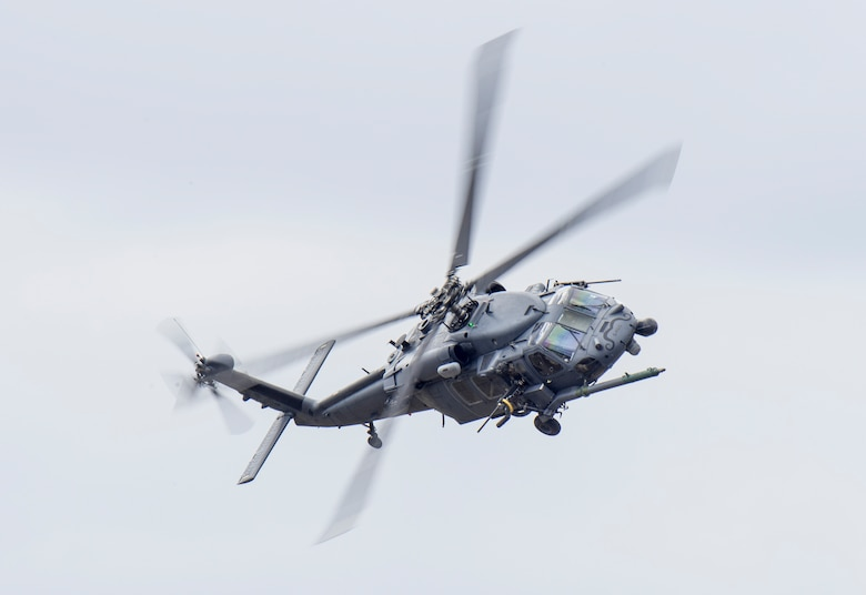 An HH-60 Pave Hawk flies over Grand Bay Bombing and Gunnery Range at Moody Air Force Base, Ga., Mar. 4, 2016. Multiple U.S. Air Force aircraft within Air Combat Command conducted joint aerial training that showcased the aircrafts tactical air and ground maneuvers, as well as its weapons capabilities. (U.S. Air Force photo by Staff Sgt. Brian J. Valencia/Released)