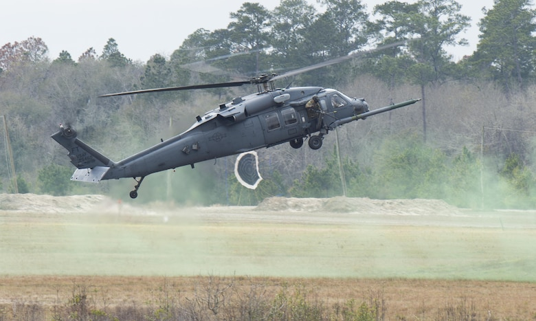 An HH-60 Pave Hawk lands for a simulated rescue on Grand Bay Bombing and Gunnery Range at Moody Air Force Base, Ga., Feb. 18, 2016. Multiple U.S. Air Force aircraft within Air Combat Command conducted joint aerial training that showcased the aircrafts tactical air and ground maneuvers, as well as its weapons capabilities. (U.S. Air Force photo by Staff Sgt. Brian J. Valencia/Released)