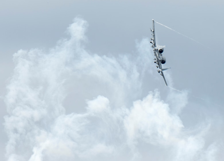 An A-10 Thunderbolt II banks through flare smoke over Grand Bay Bombing and Gunnery Range at Moody Air Force Base, Ga., Feb. 18, 2016. Multiple U.S. Air Force aircraft within Air Combat Command conducted joint aerial training that showcased the aircrafts tactical air and ground maneuvers, as well as its weapons capabilities. (U.S. Air Force photo by Staff Sgt. Brian J. Valencia/Released)