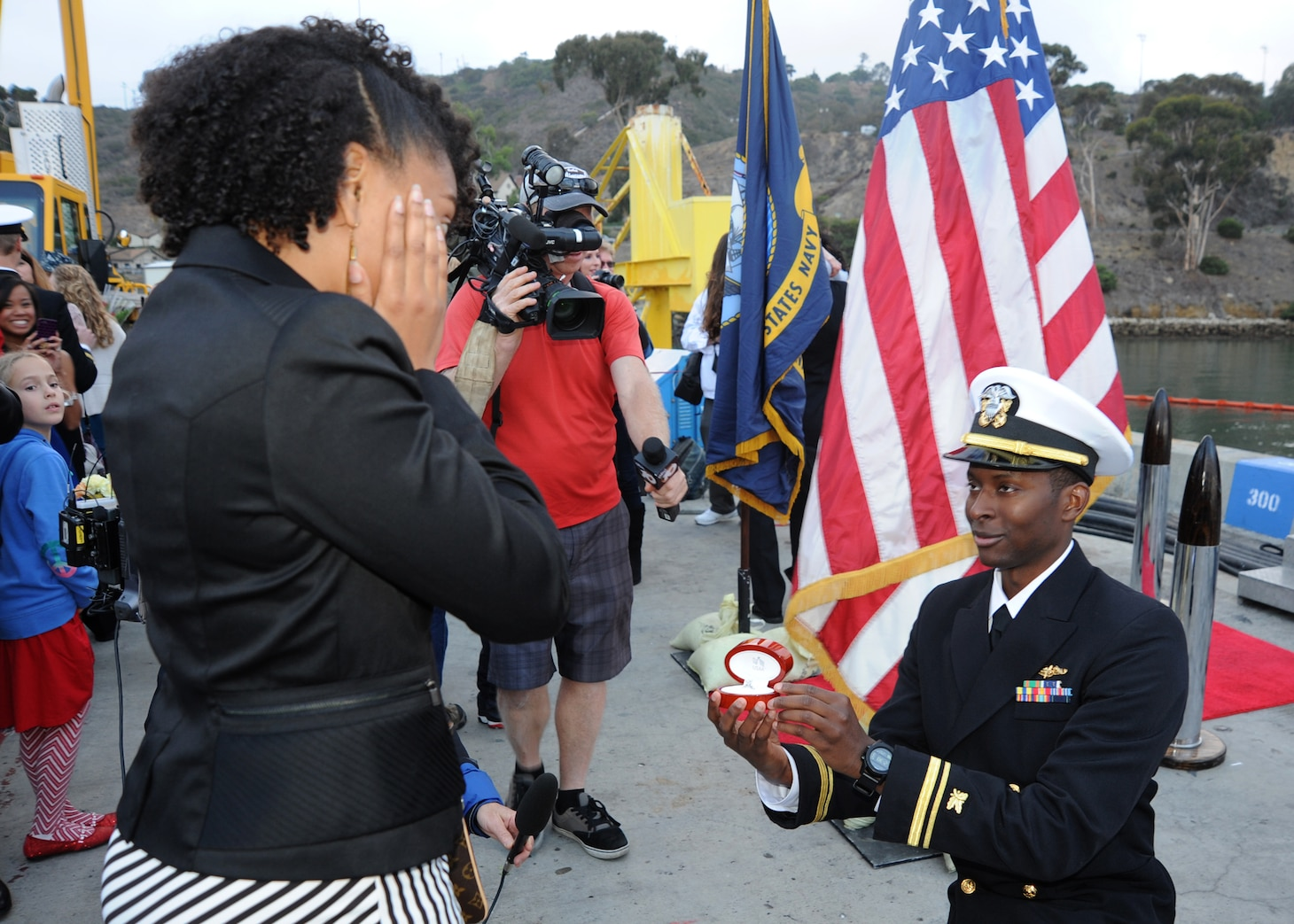 SAN DIEGO (December 18, 2013)  Lt.j.g. Justin Gay proposes to his girlfriend Cynthia Fambro following the return of the Los Angeles-class attack submarine USS USS Hampton (SSN 767) to Naval Base Point Loma after completing a six-month deployment to the western Pacific region. U.S. Navy photo by Mass Communication Specialist 2nd Class Kyle Carlstrom (Released)