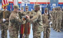 Col. Allen T. Cassell (left) and Command Sgt. Maj. Stephen M. Harris case the colors of the 1st Infantry Division Sustainment Brigade in Kuwait, which signified the transferring of its authority to the 17th Sustainment Brigade, during a March 3 ceremony at Camp Arifjan, Kuwait. During its nine-month tour, the 1st Inf. Div. Sust. Bde. oversaw the transport and issue of more than $1 billion worth of military equipment for Iraqi allies to use in its fight against Daesh, also known as ISIS.