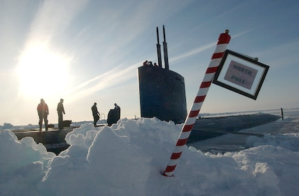 "North Polar Region (Apr. 19, 2004) - The crew of the Los Angeles-class attack submarine USS Hampton (SSN 767) posted a sign reading ""North Pole"" made by the crew after surfacing in the polar ice cap region. Hampton and the Royal Navy Trafalgar class attack submarine HMS Tireless took part in ICEX 04, a joint operational exercise beneath the polar ice cap. Both the Tireless and Hampton crews met on the ice, including scientists traveling aboard both submarines to collect data and perform experiments. The Ice Exercise demonstrates the U.S. and British Submarine Force's ability to freely navigate in all international waters, including the Arctic. U.S. Navy photo by Chief Journalist Kevin Elliott. (RELEASED)"