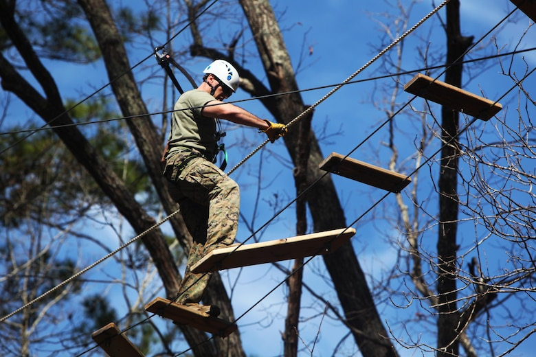 Capt. Timothy G. Otto maneuvers across a wooden rope bridge during the Devil Dog Dare Challenge Course at Marine Corps Air Station Cherry Point, N.C., March 10, 2016. The Devil Dog Dare Challenge Course was designed for Marines and Sailors to get engaged in Operation Adrenaline Rush. OAR is a training tool designed to introduce Marines to activities that serve as alternatives to uncharacteristic behaviors often associated with incidents involving recently deployed Marines. Otto is an electronic maintenance officer with G-6, 2nd Marine Aircraft Wing. (U.S. Marine Corps photo by Pfc. Nicholas P. Baird/Released)