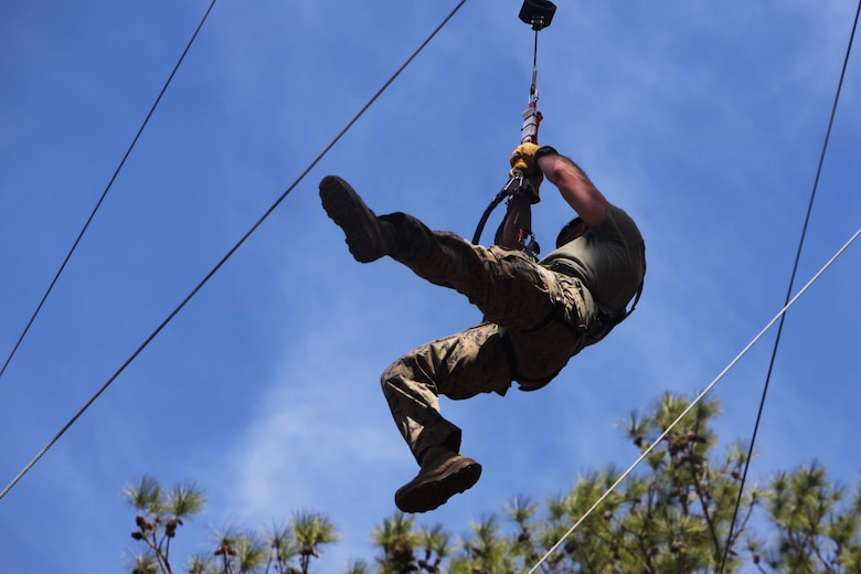 Capt. Timothy G. Otto descends from a 65-foot free fall tower during the Devil Dog Dare Challenge Course at Marine Corps Air Station Cherry Point, N.C., March 10, 2016. The Devil Dog Dare Challenge Course was designed for Marines and Sailors to get engaged in Operation Adrenaline Rush. OAR is a training tool designed to introduce Marines to activities that serve as alternatives to uncharacteristic behaviors often associated with incidents involving recently deployed Marines. Otto is an electronic maintenance officer with G-6, 2nd Marine Aircraft Wing. (U.S. Marine Corps photo by Pfc. Nicholas P. Baird/Released)